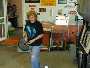 Audrey spinning glass in her studio 2012