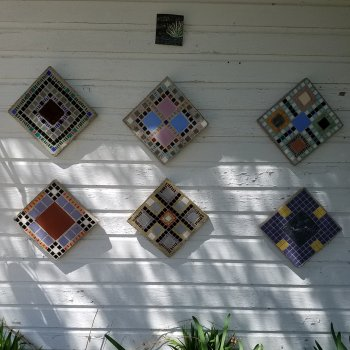 Six mosaic medallions outside